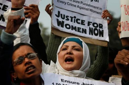 Indian women shout slogans as they protest against a recent gang-rape